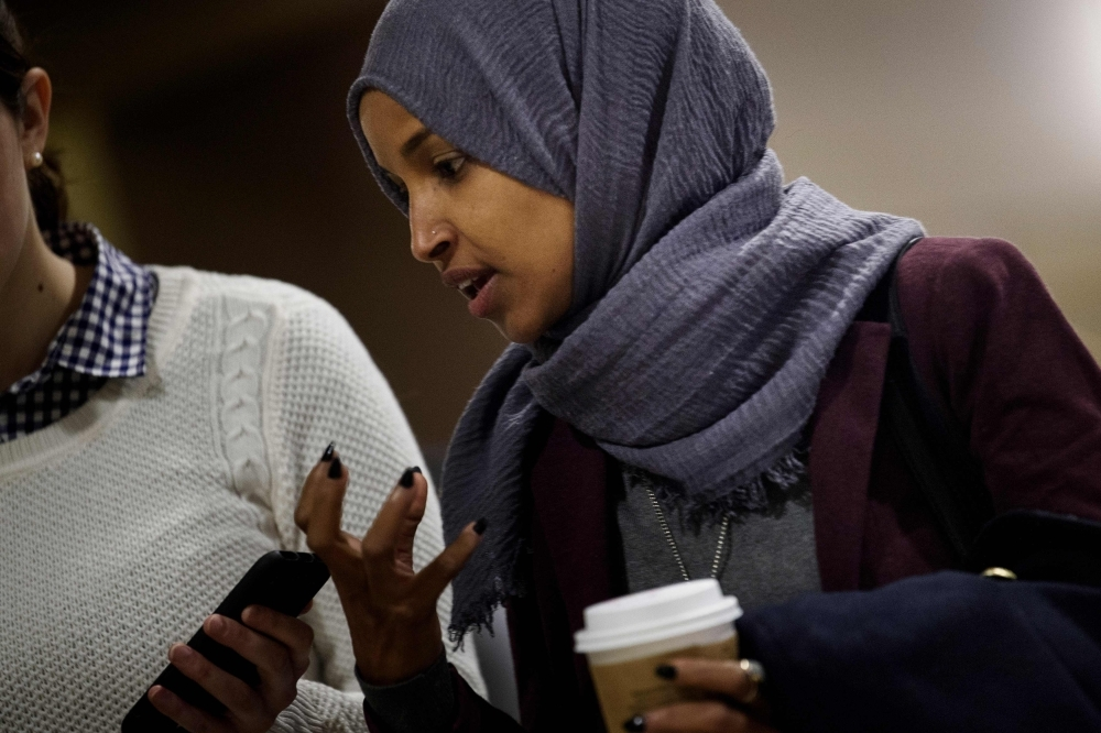 Incoming Representative Ilhan Omar speaks to a reporter while arriving for a House of Representatives member-elect welcome briefing on Capitol Hill Thursday in Washington, DC. — AFP