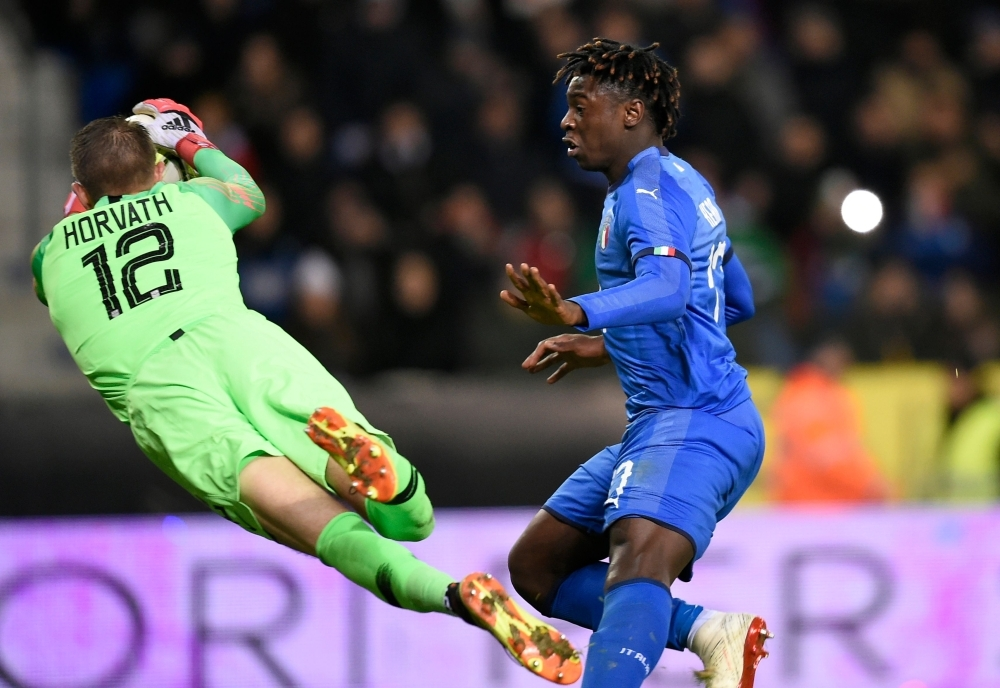 Unites States' goalkeeper Ethan Horvath (L) saves the ball in front of Italy's forward Moise Kean (R) during the friendly football match between Italy and the USA at the Luminus Arena Stadium in Genk on Tuesday. — AFP