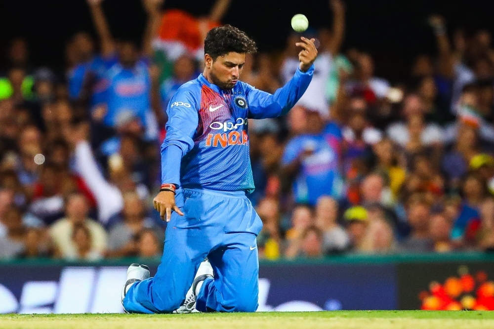 India's bowler Kuldeep Yadav celebrates the caught and bowled wicket of Australia's Chris Lynn during the T20 international cricket match between Australia and India in Brisbane on Wednesday.  — AFP