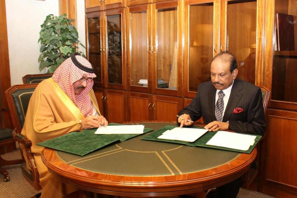 Prince Mishal Bin Bader Bin Saud Bin Abdul Aziz, Undersecretary of the National Guard and Yusuff Ali MA, Chairman and Managing Director of LuLu Group International, sign the agreement at King Fahad National Guard office in Dammam on Wednesday