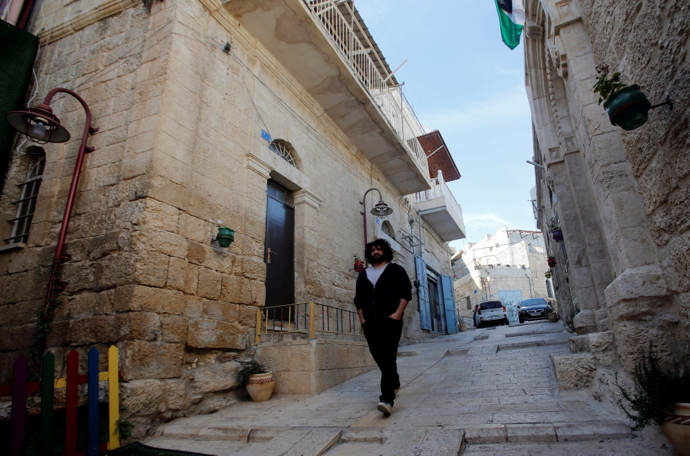 Palestinian musician Firas Harb walks in Beit Sahour, in the occupied West Bank, in this Nov. 20, 2018 file photo. — Reuters