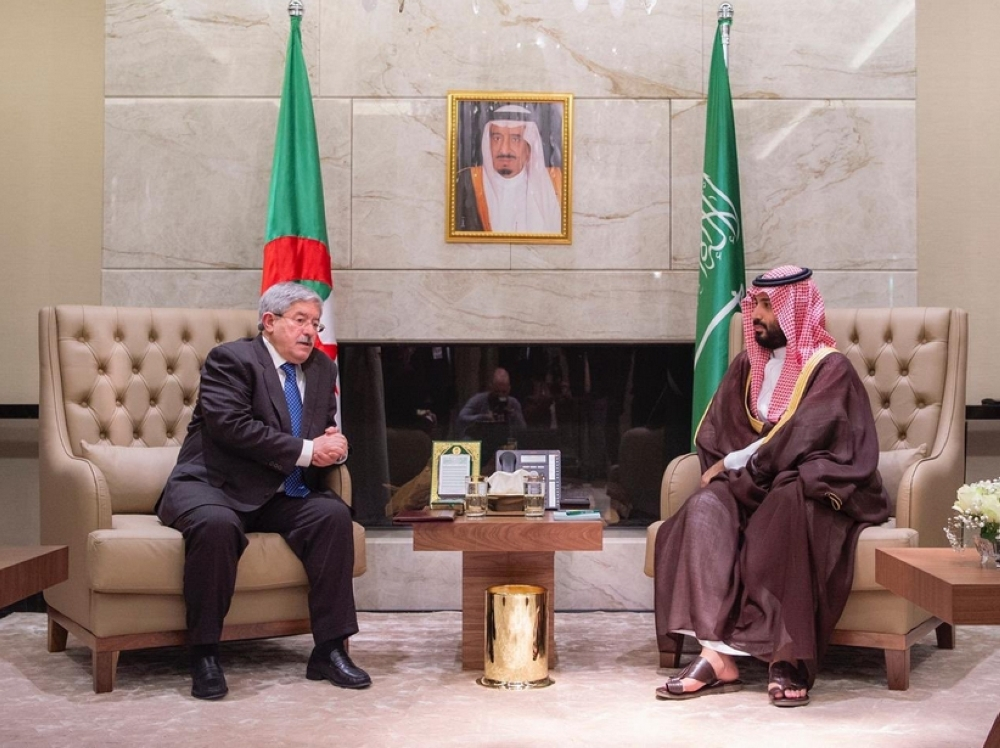Crown Prince Muhammad Bin Salman, deputy premier and minister of defense, and Algerian Prime Minister Ahmed Ouyahia hold talks in Algiers on Monday. — SPA