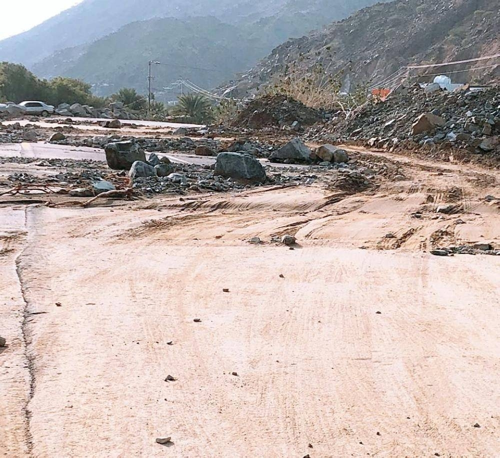 Flash floods transport mud and rock to the roads, leading to their closure.