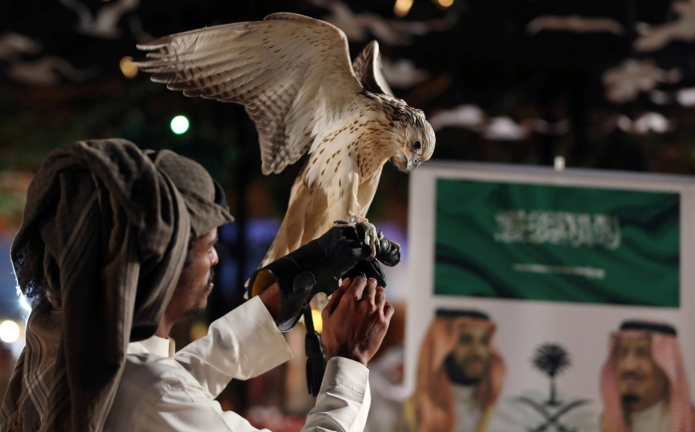 A man shows a falcon at the first Saudi Falcons and Hunting Exhibition in Riyadh, Saudi Arabia, December 5, 2018. REUTERS