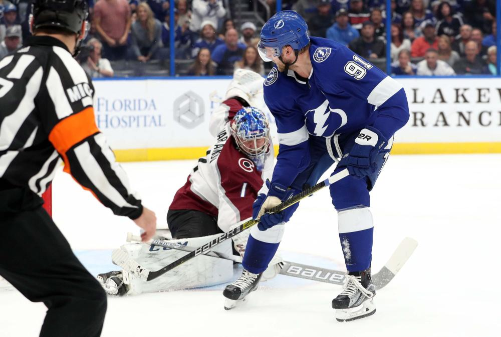 Tampa Bay Lightning's center Steven Stamkos scores a goal against Colorado Avalanche goaltender Semyon Varlamov during their NHL game at Amalie Arena in Tampa Saturday. — Reuters