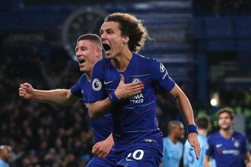Chelsea's defender David Luiz (R) celebrates with Ross Barkley after scoring their second goal during the English Premier League football match against Manchester City at Stamford Bridge in London Saturday. — AFP