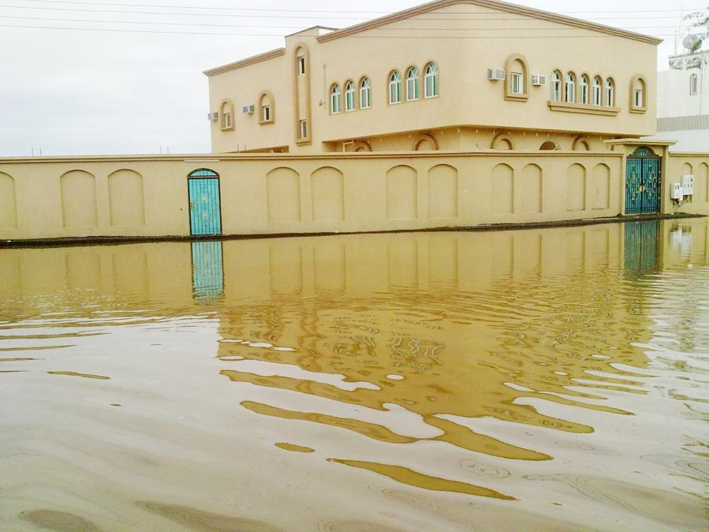 Many huses in Jamoum outside Makkah are surrounded by water following rain.