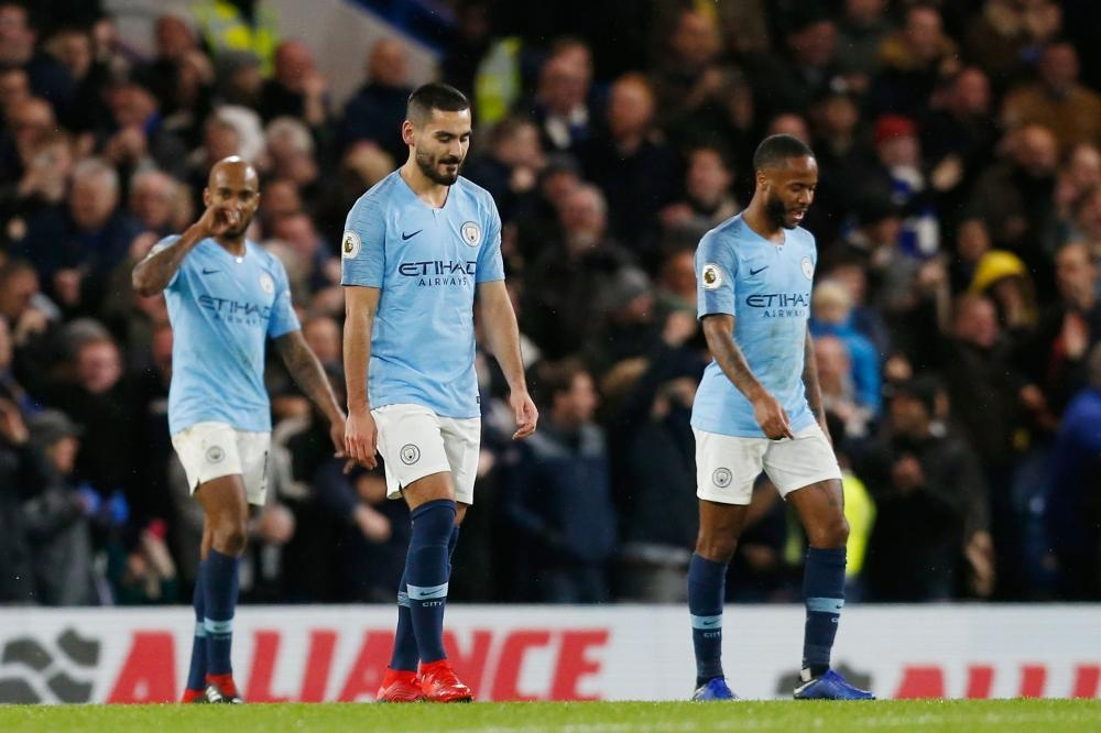 Manchester City's Fabian Delph (L), Ilkay Gundogan (C) and Raheem Sterling react after Chelsea scored its second goal during their English Premier League football match at Stamford Bridge in London Saturday. — AFP