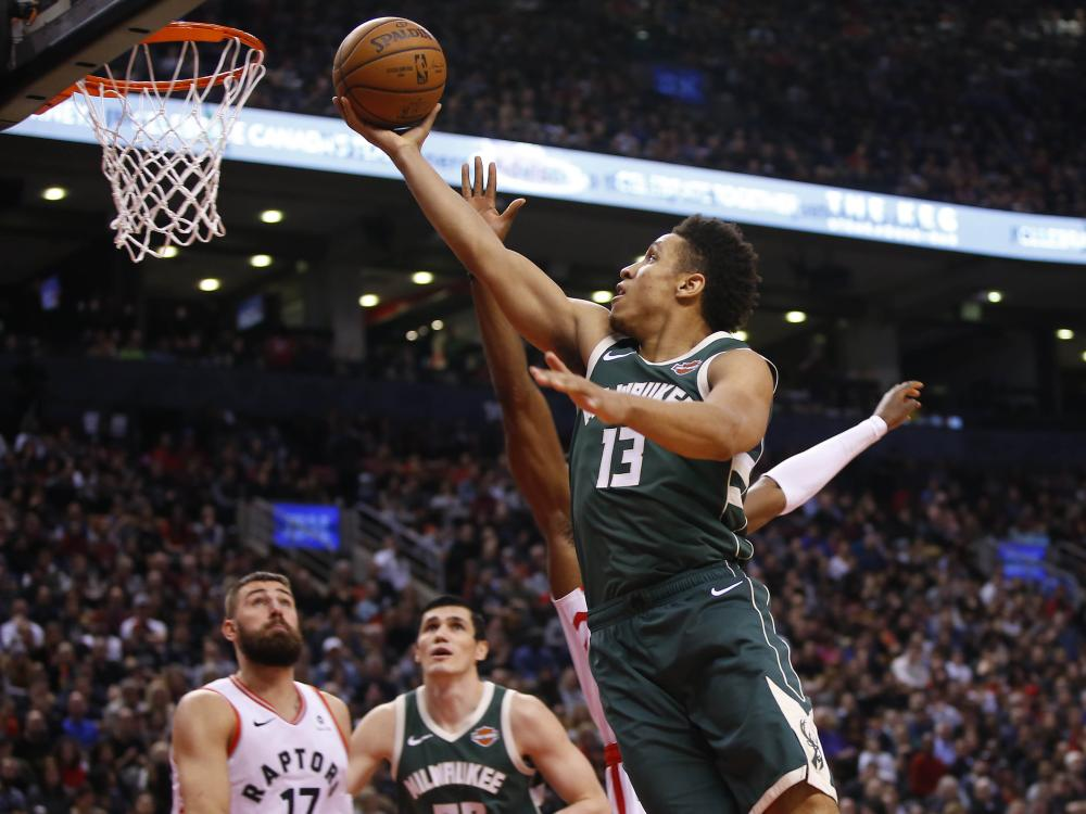 Milwaukee Bucks' guard Malcolm Brogdon goes up to make a basket against the Toronto Raptors during their NBA game at Scotiabank Arena in Toronto Sunday. — Reuters