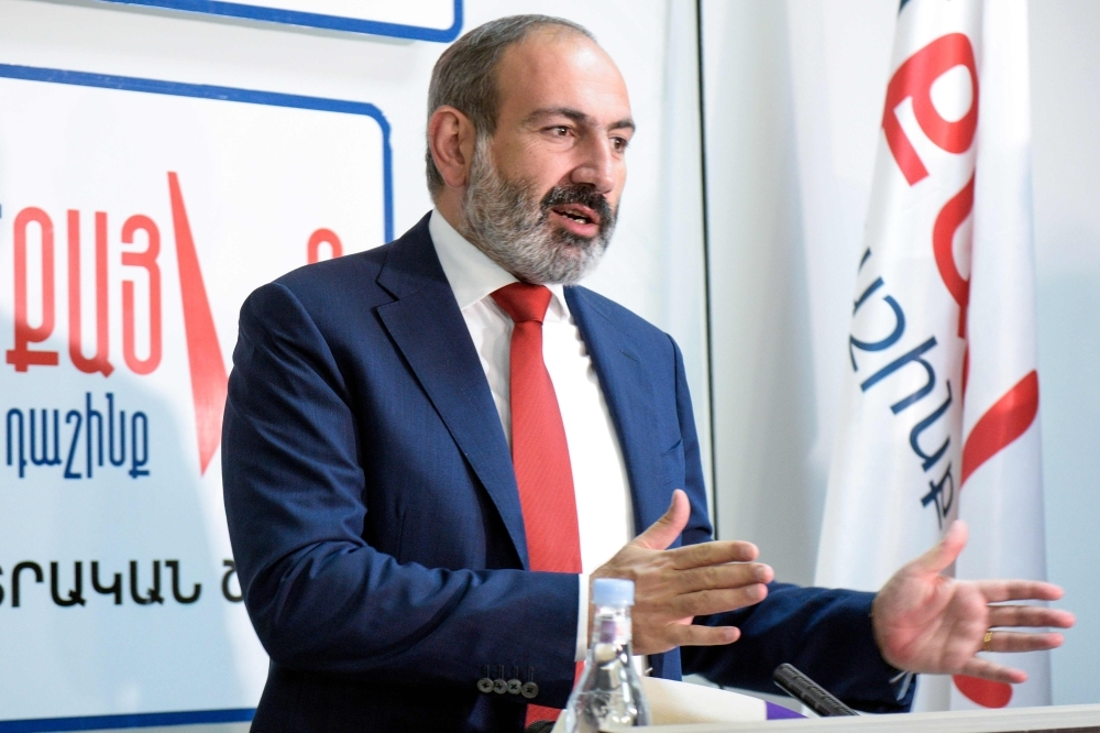 Armenia's acting Prime Minister Nikol Pashinyan meets with the media in Yerevan early on Monday. — AFP
