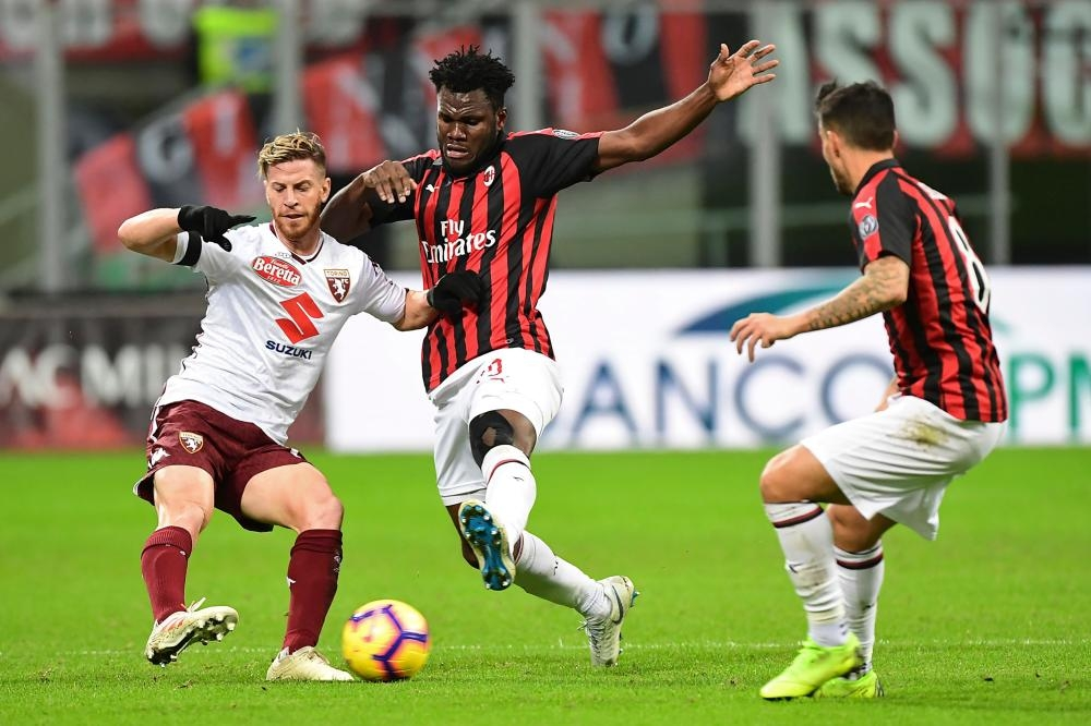Torino's Cristian Ansaldi (L) vies with AC Milan's Franck Kessie during their Italian Serie A football match at the San Siro Stadium in Milan Sunday. — AFP