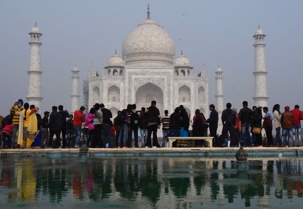 Crowds gather to visit the Taj Mahal in Agra in this Jan. 3, 2018 file photo. — AFP