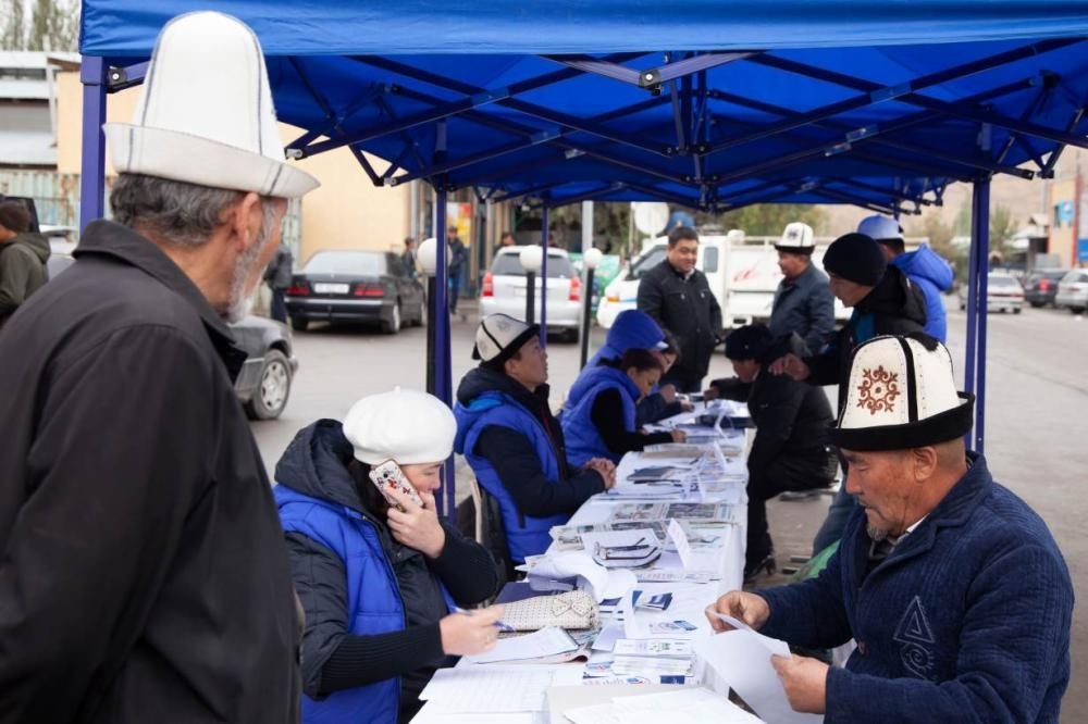 Lawyers, part of the 'Bus of Solidarity', supported by the Ministry of Justice and United Nation Development Project, give free legal consultation in Kara-Kulja in southern Kyrgyzstan, in this Oct. 16, 2018 file photo. — Thomson Reuters Foundation