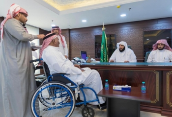 Minister of Justice and President of the Supreme Judicial Council Sheikh Walid Al-Samaani meets beneficiaries of judicial services during an event in Makkah on Monday. — SPA