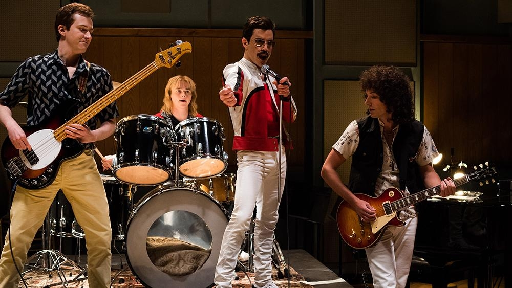 L-R: Joe Mazzello (John Deacon), Ben Hardy (Roger Taylor), Rami Malek (Freddie Mercury), and Gwilym Lee (Brian May) star in Twentieth Century Fox's BOHEMIAN RHAPSODY. — Photo Credit: Alex Bailey