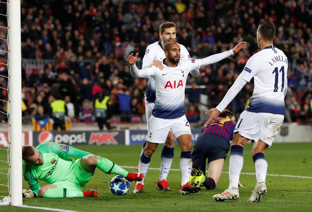 Tottenham's Lucas Moura celebrates with Fernando Llorente and Erik Lamela after scoring against Barcelona during their Champions League match at Camp Nou, Barcelona, Tuesday. — Reuters