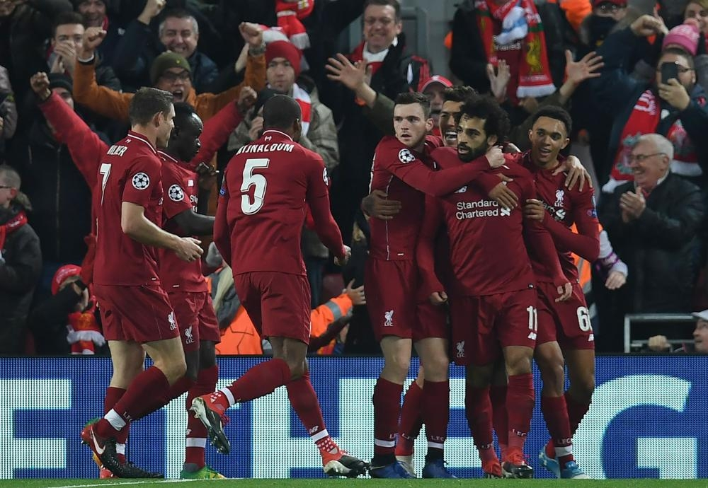 Liverpool's Mohamed Salah (2nd R) celebrates scoring during the UEFA Champions League match against Napoli at Anfield Stadium in Liverpool Tuesday. — AFP