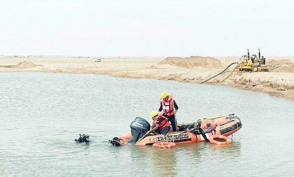 Civil Defense rescue teams dry up the lake during the search operation.