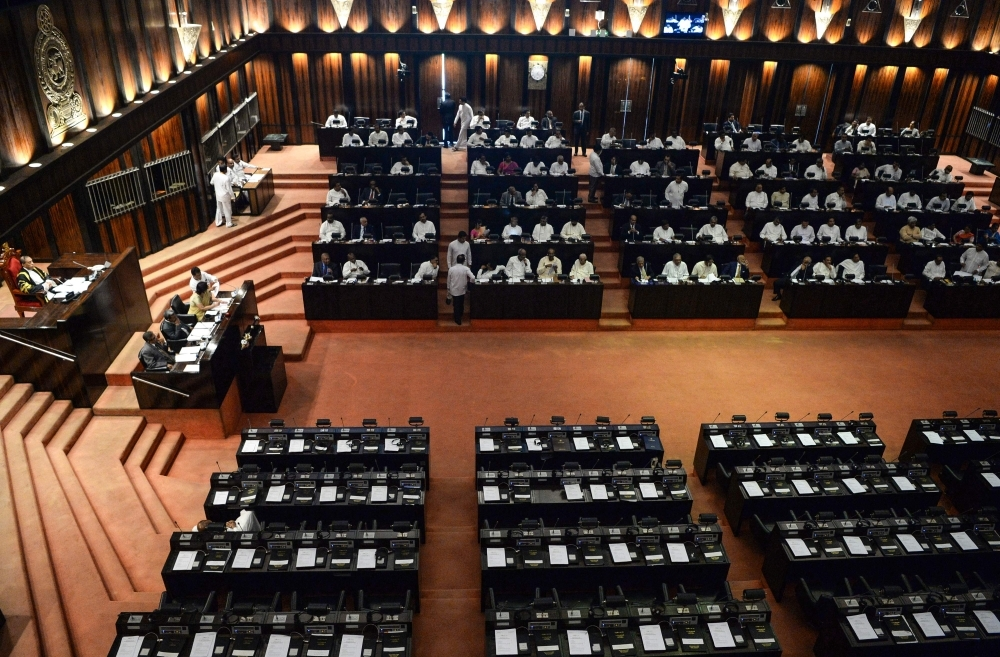 Members of parliament attend a parliament session at Sri Lankan parliament hall in Colombo on Wednesday. — AFP