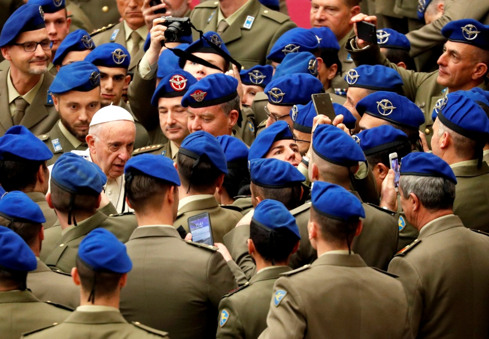 Pope Francis is seen surrounded by Italian soldiers during the weekly general audience at Paul VI hall at the Vatican on Wednesday. — Reuters
