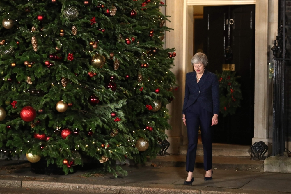 British Prime Minister Theresa May arrives to make a statement outside 10 Downing Street in central London after winning a confidence vote on Thursday. — AFP