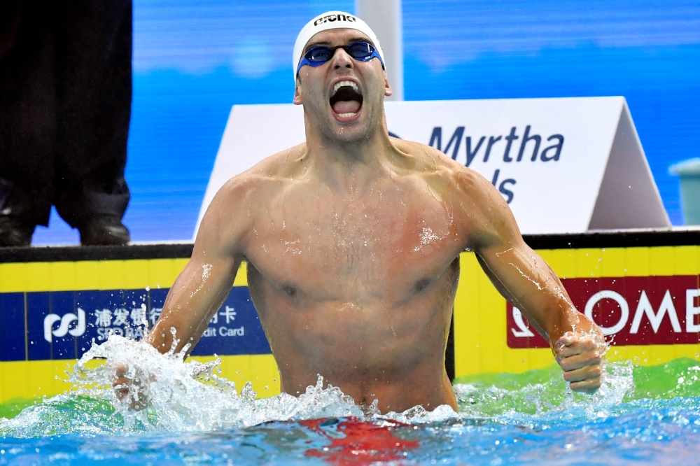 818ddd10a0e Chad le Clos of South Africa celebrates after winning the Men 100m  Butterfly Finals race at