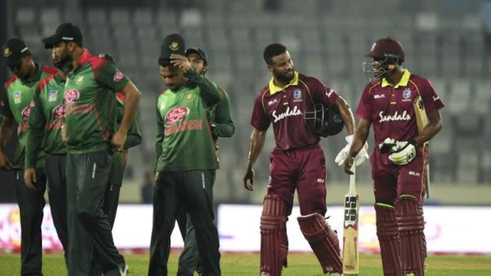 Bangladesh and West Indies players walk off the ground after the visitors win in Dhaka that leveled the ODI series.