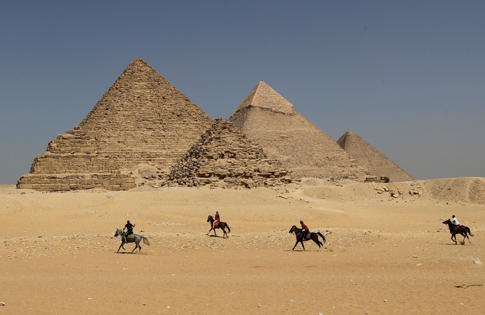 Horse riders gallop near the Giza pyramids, on the southwestern outskirts of the Egyptian capital Cairo, in this Oct. 02, 2018 file photo. — AFP
