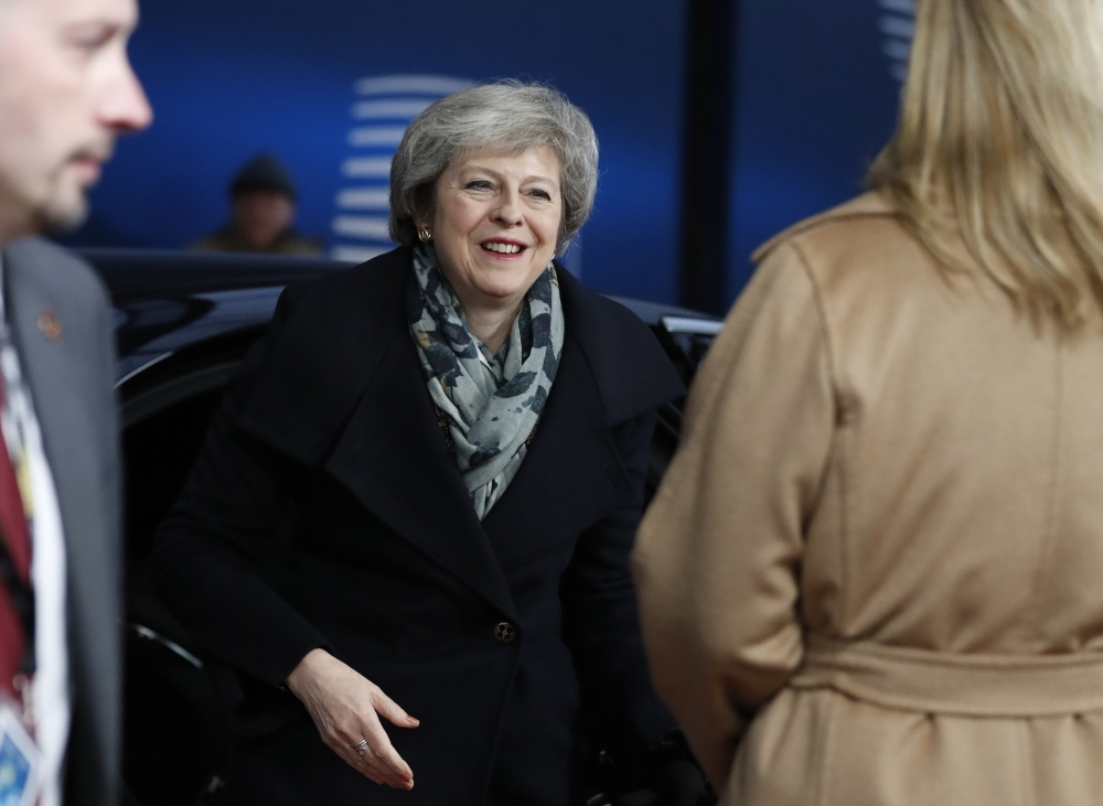 British Prime Minister Theresa May arrives in Brussels on Friday during the second day of a European Summit aimed at discussing the Brexit deal, the long-term budget and the single market. — AFP