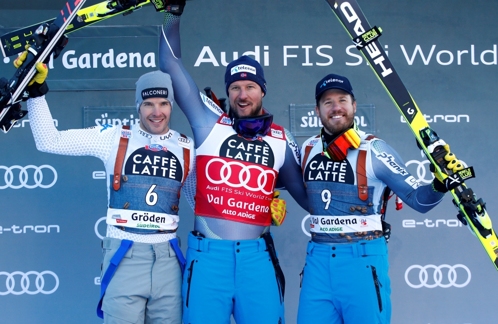 Norway's Aksel Lund Svindal celebrates his Alpine Skiing World Cup Men's Super G win with second placed Italy's Christof Innerhofer and third placed Norway's Kjetil Jansrud at Val Gardena, Italy, on Friday. — Reuters