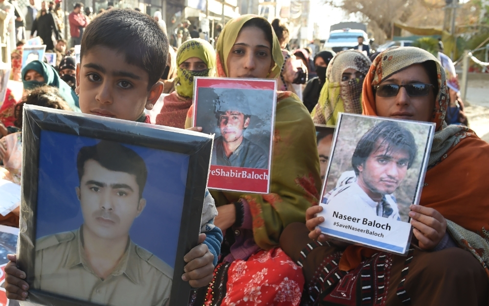 Relatives of missing Pakistanis hold pictures of their loved ones in a demonstration during Human Rights Day in Quetta, the capital city of Balochistan province, in this Dec. 10, 2018 file photo. — AFP