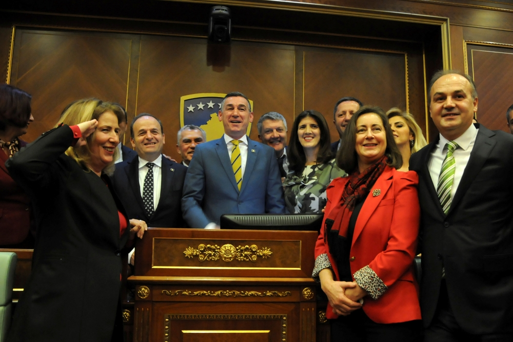 Kosovo's parliament speaker Kadri Veseli, center, and lawmakers smile after parliament approved formation of national Kosovo army in Pristina, Kosovo, on Friday. — Reuters