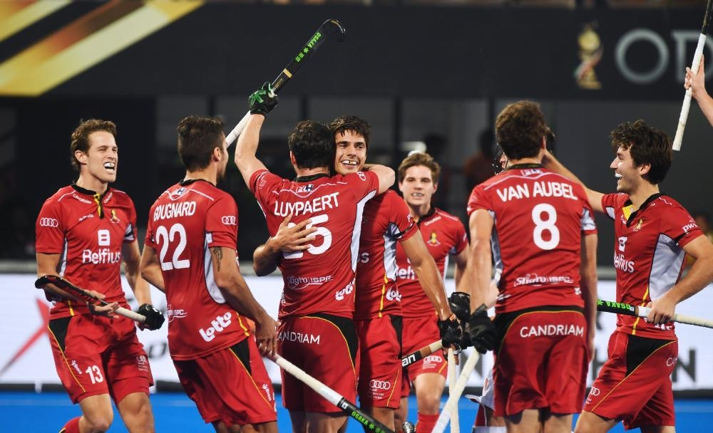 Belgium's Alexander Hendrickx (C) celebrates with teammates after scoring a goal against England during the field hockey semifinal of the 2018 Hockey World Cup in Bhubaneswar Saturday. — AFP