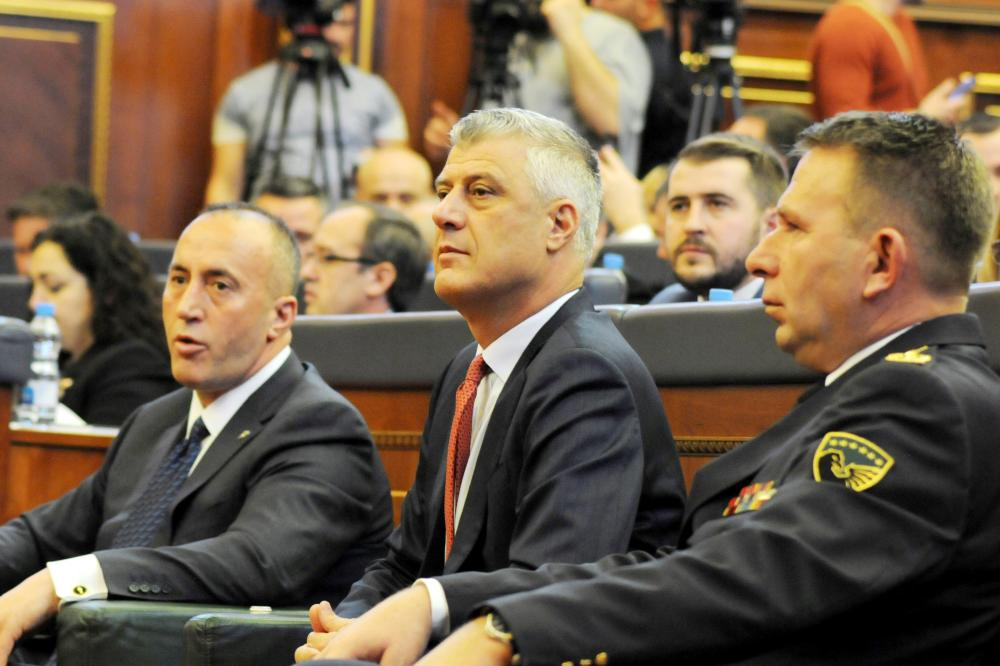 Kosovo's President Hashim Thaci (center), Prime Minister Ramush Haradinaj (left) and Kosovo Security Forces Commander Lt. Gen. Rrahman Rama attend a session after parliament approved formation of national Kosovo army in Pristina, Kosovo, Friday. — Reuters