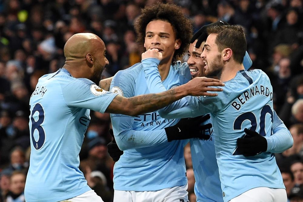 Manchester City's striker Gabriel Jesus (2nd R) celebrates scoring his team's first goal during their English Premier League match against Everton at the Etihad Stadium in Manchester Saturday. — AFP