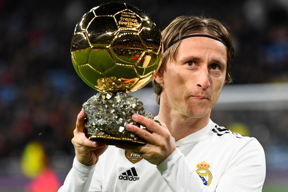 Real Madrid's Luka Modric poses with his Ballon d'Or trophy before the Spanish League football match between Real Madrid and Rayo Vallecano at the Santiago Bernabeu stadium in Madrid Saturday. — AFP