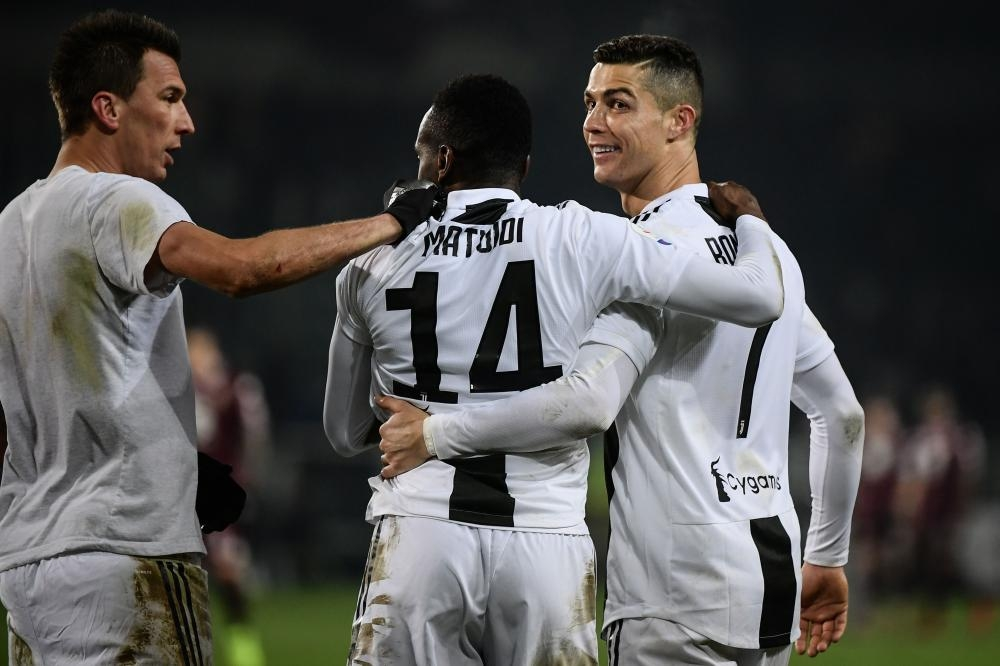 (From L) Juventus' forward Mario Mandzukic, midfielder Blaise Matuidi and forward Cristiano Ronaldo celebrate at the end of the Italian Serie A football match against Torino at the Olympic Stadium in Turin Saturday. — AFP