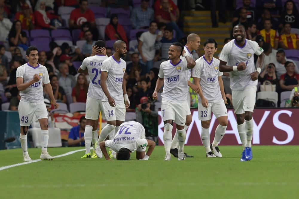Al ain's players celebrates after scoring a goal during the second round match of the FIFA Club World Cup 2018 football tournament between Tunisia's Esperance Tunis and Kashima Antlers and Abu Dhabi's al Ain at the Hazza Bin Zayed Stadium in Abu Dhabi, the capital of the United Arab Emirates, on December 15, 2018.  / AFP / Giuseppe CACACE