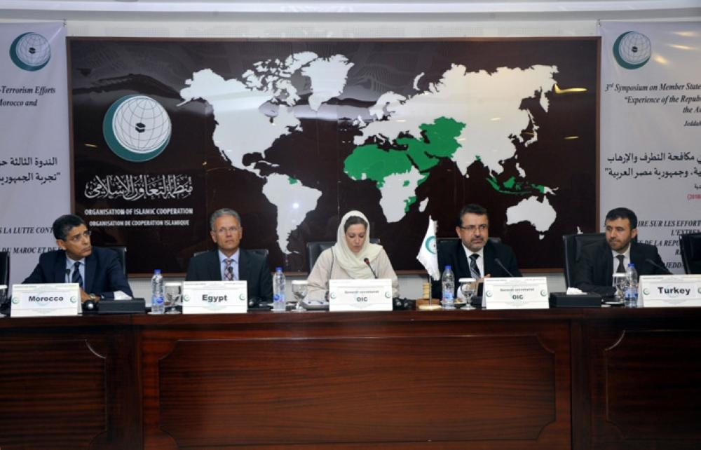 Speakers attend a symposium in Jeddah on Sunday on OIC member states' efforts in combating terrorism and violent extremism. — SPA