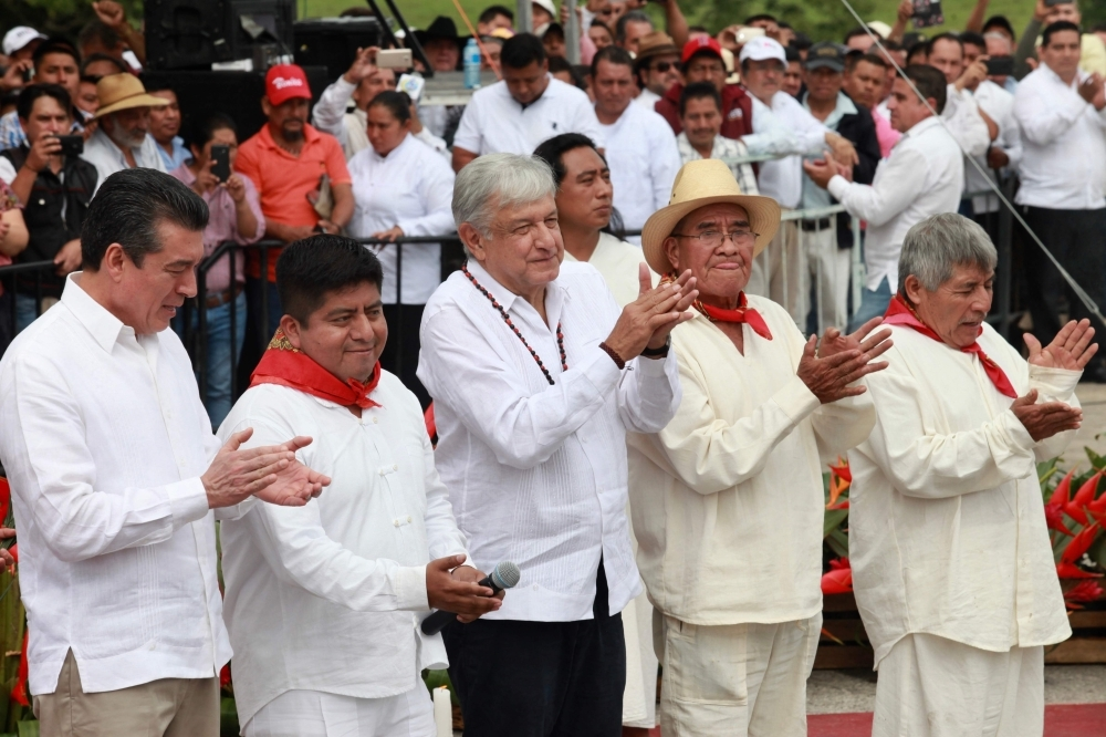 President Andres Manuel Lopez Obrador, center, takes part in the ceremony to launch the construction of the Tren Maya, a new railway network in the Yucatan peninsula in southeast Mexico, in Palenque, Chiapas state, on Sunday. — AFP