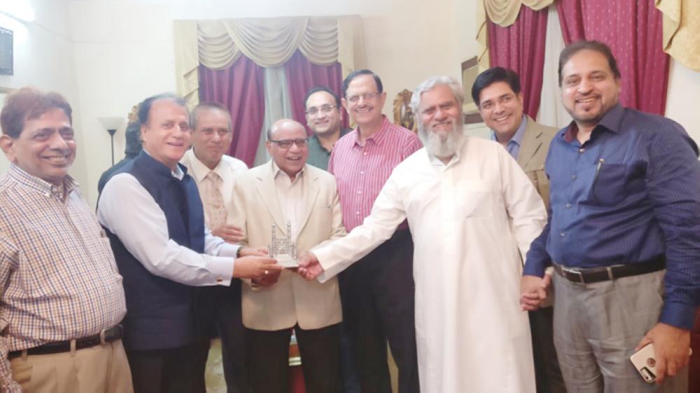 Members of the ICSJ and Bazm-e-Osmania present a memento to Dr. Dilshad Ahmed Shamsi. Photo shows from left, Iqbal Sheikh Al-Sulkar, Arif Quraishi, Dr. Haroon Rasheed, Dr. Shamsi, Zeeshan Khan, Dr. M.S. Karimuddin, Aziz Kidwai, Syed Fazal Ul Haque, and Ameen Ansari.