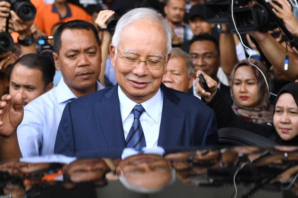 Former Malaysia's Prime Minister Najib Razak leaves the courthouse in Kuala Lumpur after being charged in court in this Dec. 12, 2018 file photo. — AFP