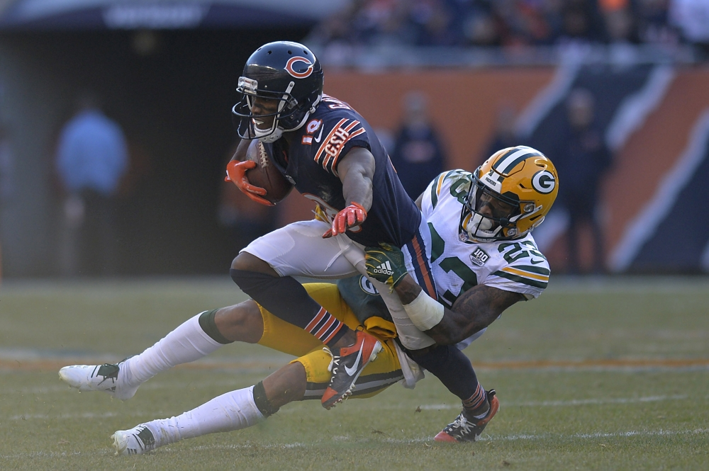 Chicago Bears' wide receiver Taylor Gabriel is tackled by Green Bay Packers' cornerback Jaire Alexander during their NFL game at Soldier Field in Chicago Sunday. — Reuters
