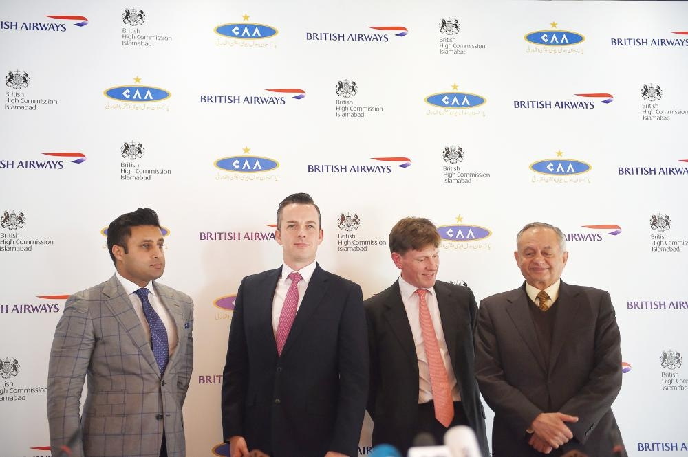 From left to right: Special Assistant to Pakistani Prime Minister for Overseas Zulfi Bukhari, Robert Williams, British Airways head of Sales for Asia Pacific and the Middle East, acting British High Commissioner Richard Crowder and Pakistani Prime Minister Imran Khan's adviser on commerce Abdul Razak Dawood pose for a photograph after a press conference in Islamabad on Tuesday. — AFP