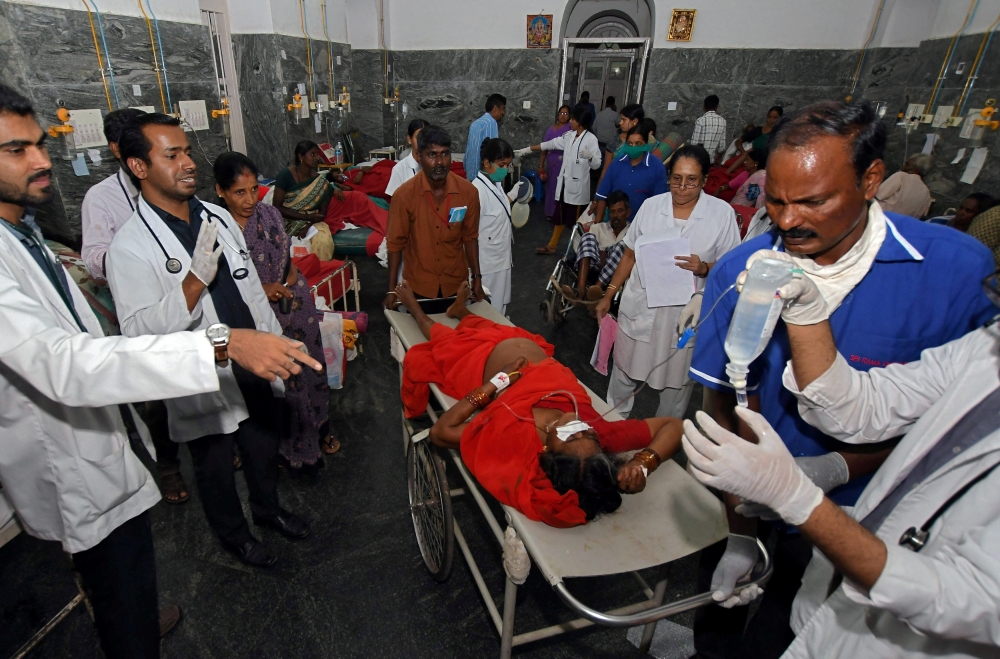 Medics tend to people who were hospitalized after consuming a religious food offering at a temple, inside hospital in the southern city of Mysuru, India, in this Dec. 14, 2018 file photo. — Reuters