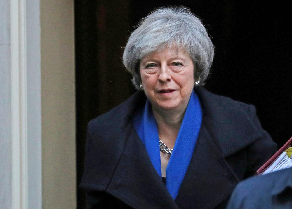 Britain's Prime Minister Theresa May leaves 10 Downing Street in London on Wednesday. — Reuters