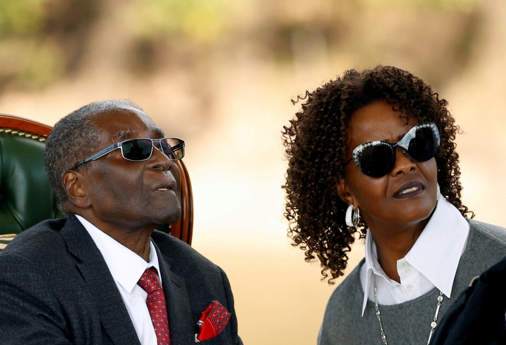 """Zimbabwe's former President Robert Mugabe and his wife Grace, right, look on after addressing a news conference at his private residence nicknamed """"Blue Roof"""" in Harare in this July 29, 2018 file photo. — Reuters"""