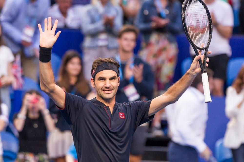 Roger Federer of Switzerland acknowledges the crowd after defeating Cameron Norrie of Britain at the Hopman Cup Tennis Tournament in Perth Sunday. — AFP