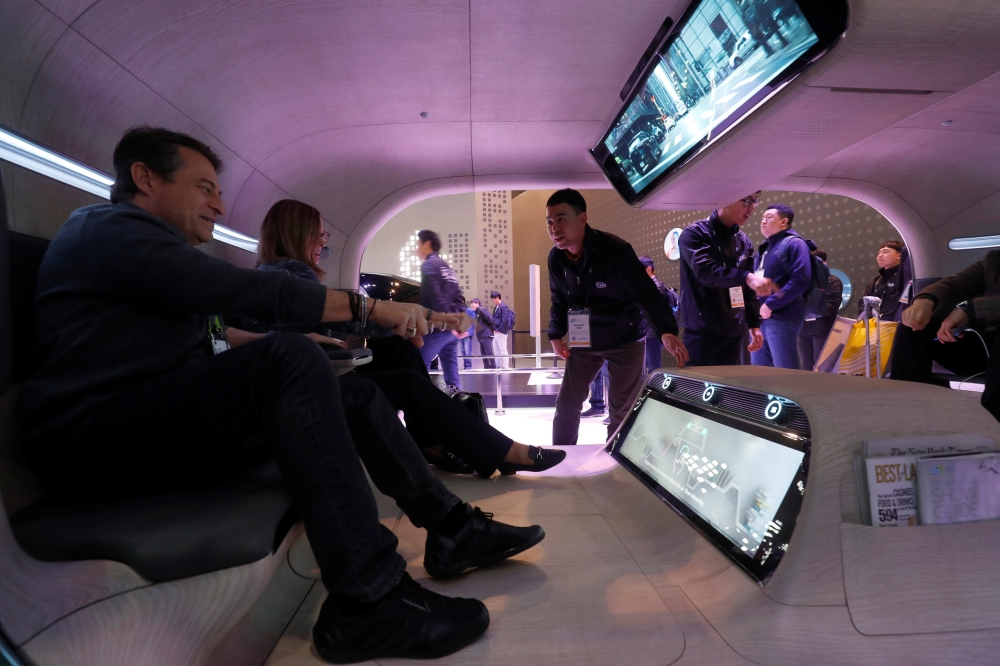 Passengers use gesture control to access functions in a mock-up of an autonomous vehicle in the Kia booth  Kia during the 2019 CES in Las Vegas, Nevada, on Tuesday. — Reuters