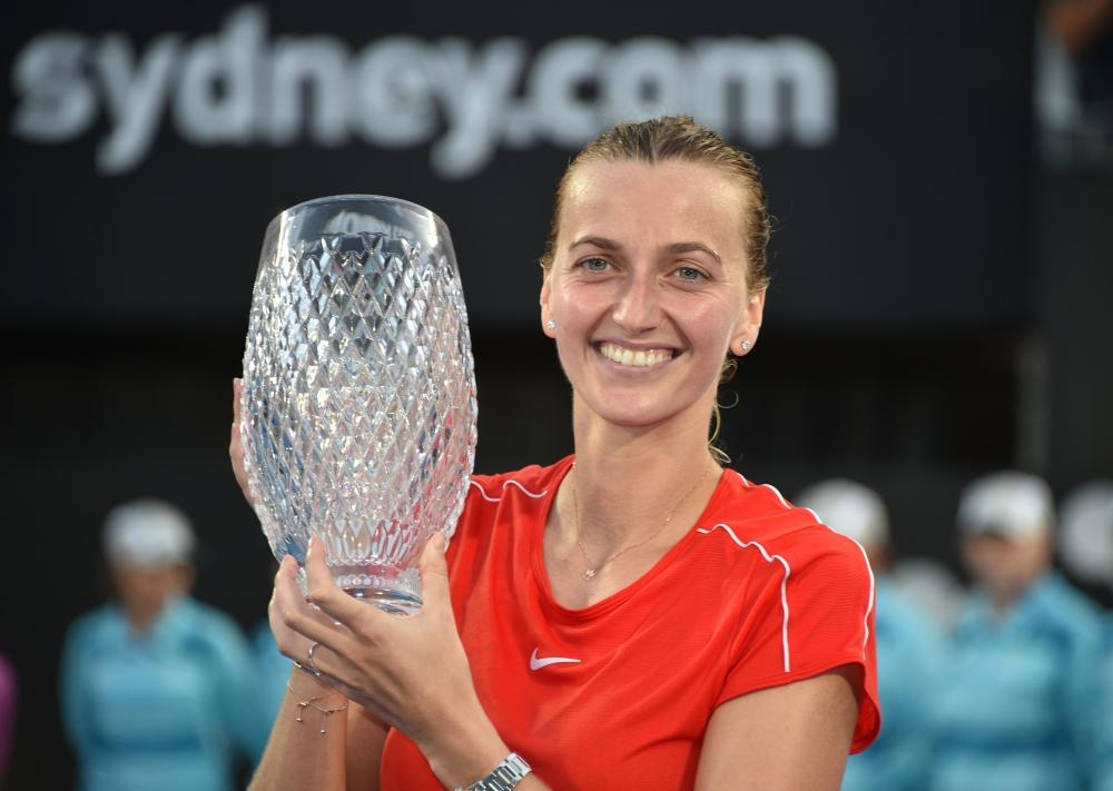 Petra Kvitova of the Czech Republic holds the trophy after beating Australia's Ashleigh Barty in the final at the Sydney International Tennis Tournament Saturday. — AFP